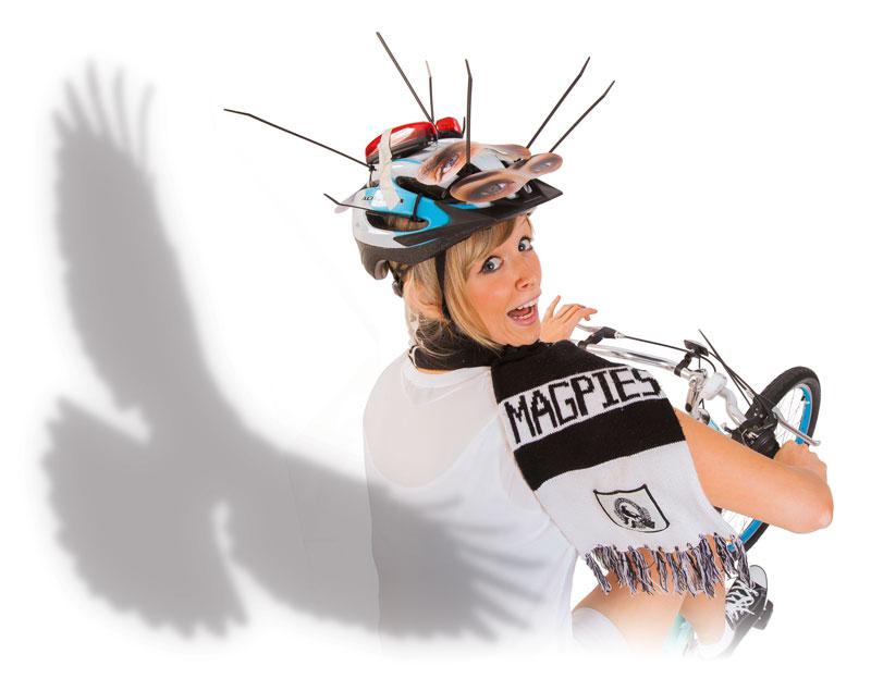 Magpie swooping bike rider