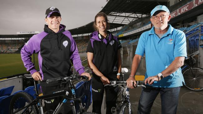 Garry Bailey with Hobart Hurricanes players Cameron Boyce and Erin Burns at Blundstone Arena.