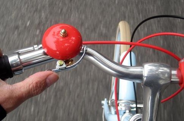 Bell and voice are used for communication by experienced bike riders
