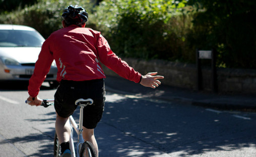 The right hand signal is legally required communication for bike riders in Australia