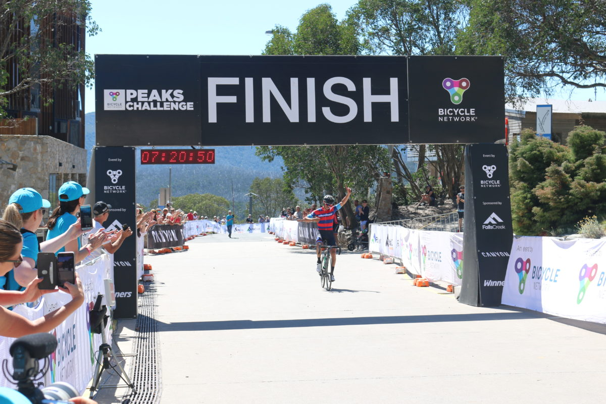Dan Bonello crosses the finish line at Peaks Challenge Falls Creek