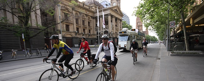 Bike riders outside Melbourne Town Hall