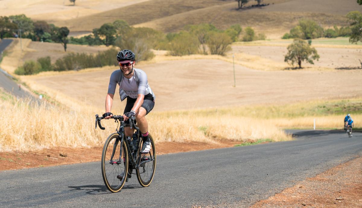 Cyclist climbing piggery hill