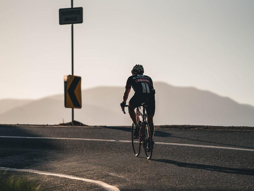 Cyclist climbing Tawonga Gap