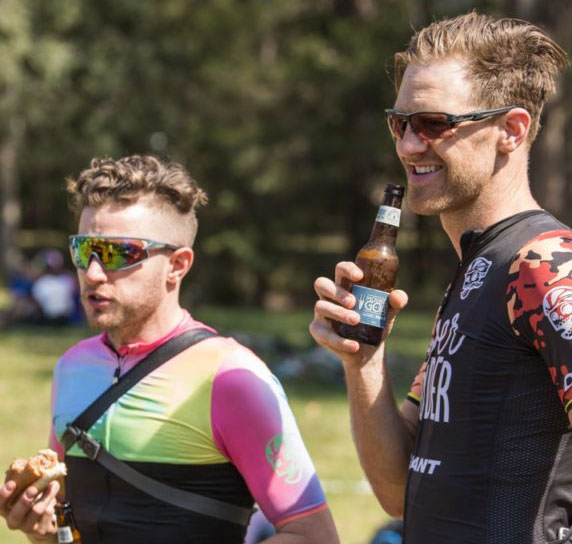 Cyclists enjoying a post-ride beverage